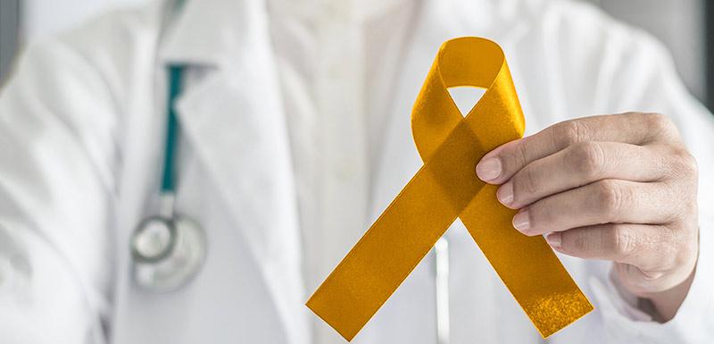ruban d'or symbolisant cancer chez l'enfant