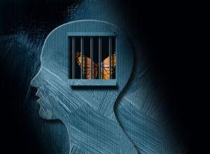 Papillon emprisonné derrière les barres de prison émotionnelles dans le cerveau